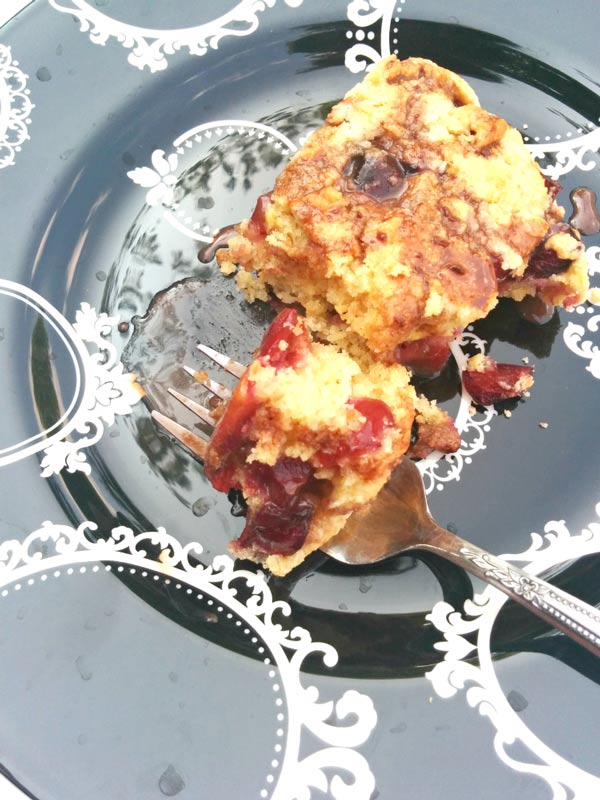 Slice of Cherry Scones with Chocolate Whiskey Sauce.