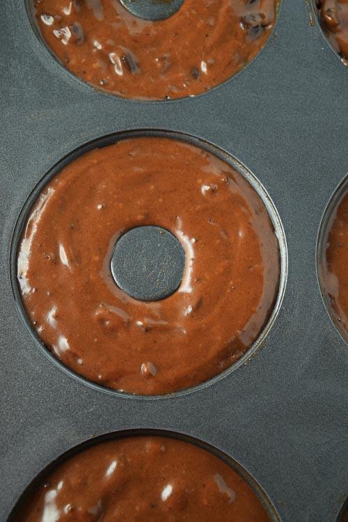 Baked Chocolate Fudge Cake Donuts batter in donut pan