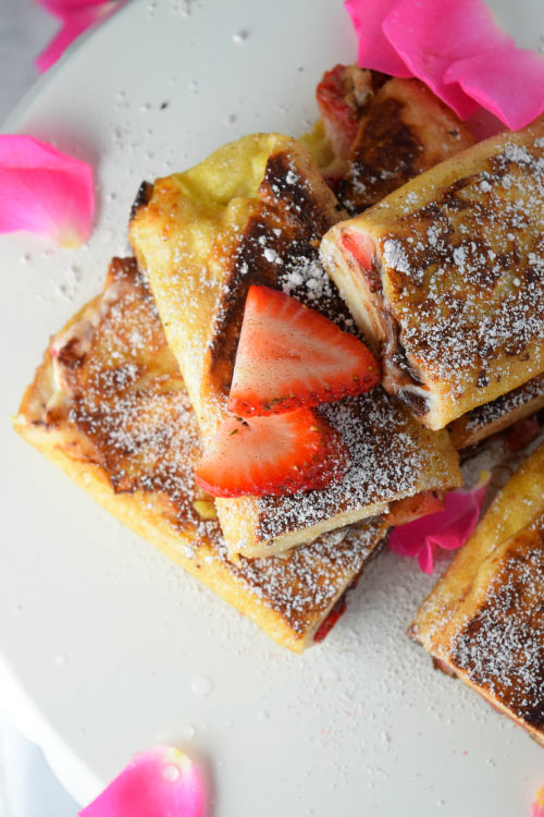 Chocolate Strawberry Cheesecake dripping out of Tortilla French Toast