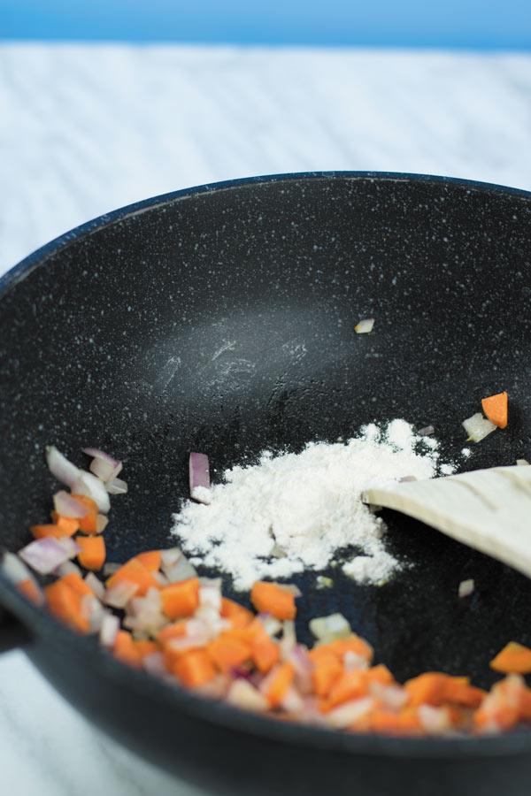 adding flour for cheesy buffalo chicken casserole