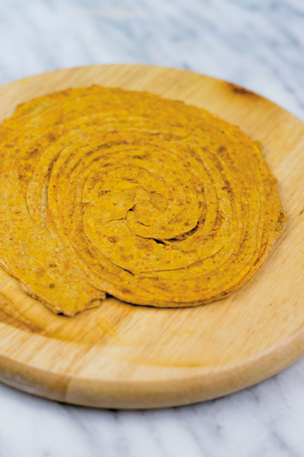 fully rolled out achaari lachha paratha