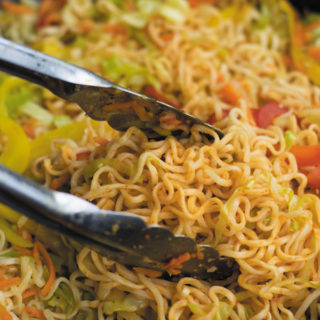 Spicy Schezwan Chowmein Noodles - cheap ramen noodles used without seasoning packets, with tons of fresh vegetables and spicy schezwan sauce. A quick 20 MINS dinner that keeps U & Your wallet full!