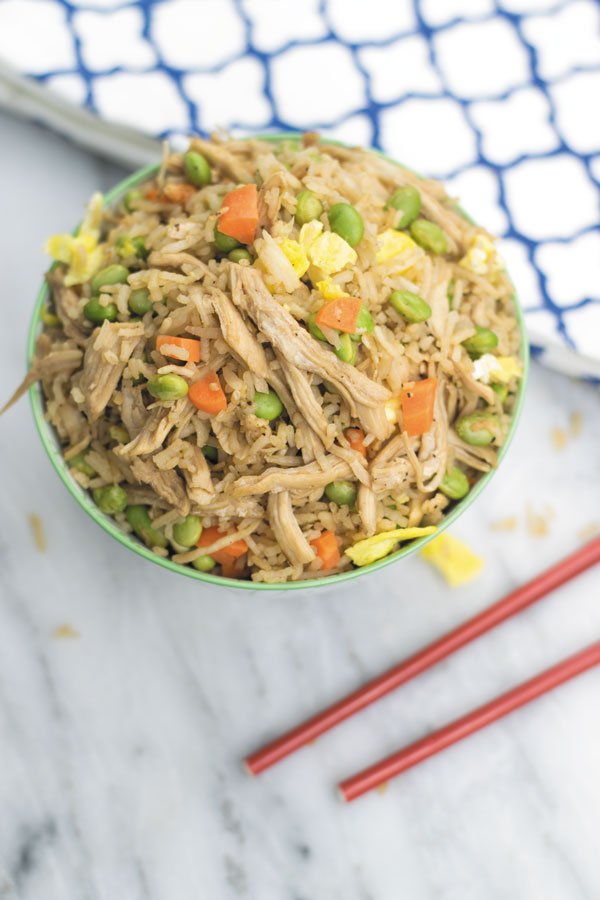 This super delicious CHICKEN FRIED RICE takes 30 mins start to finish, packed with marinated shredded chciken and tons of veggies, this is one meal that will leave you satisfied!