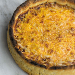 Deep Dish Pizza - Cheesy CHICAGO STYLE pizza, with a SECRET INGREDIENT in the crust that makes is soft & chewy!