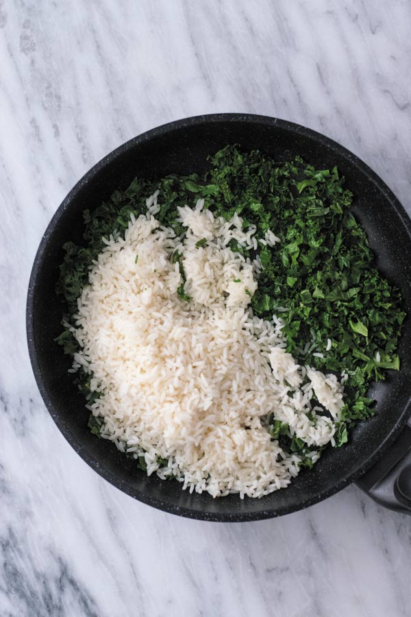 Spicy Kale Fried Rice - Just 15 Mins to make this amazing side dish or adding a protein of choice makes it into a filling meal! It's been on a regular DINNER rotation at our place. My family asks for it every other night for dinner!