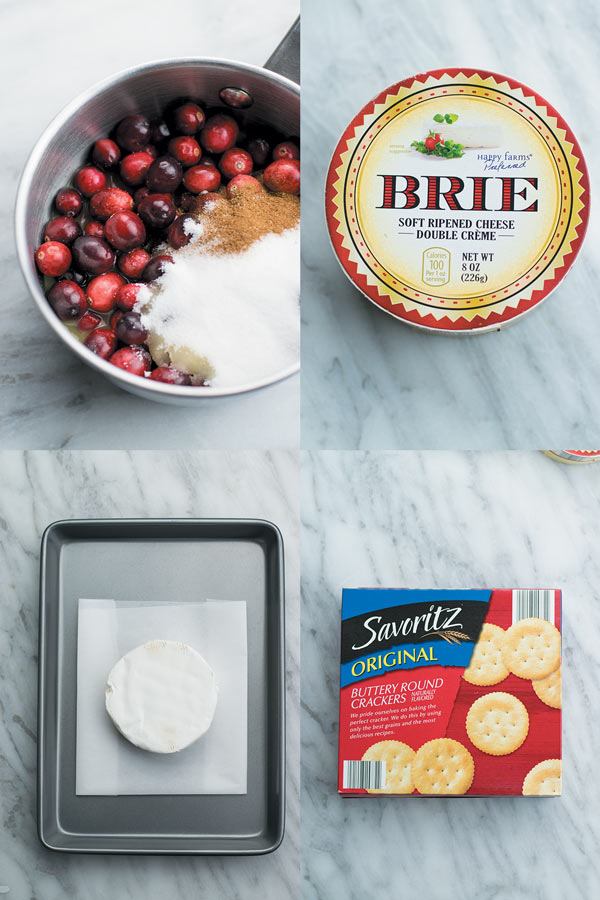 Baked brie with orange cranberry sauce - Delicious & simple holiday appetizer. Baked brie served with a simple yet beautifully flavored orange cranberry sauce!