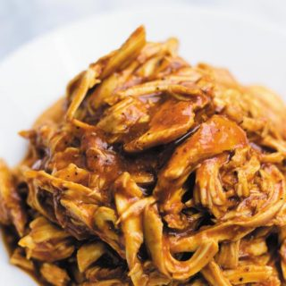 Slow Cooker BBQ Shredded Chicken - just 3 ingredients are all you need to make this delicious BBQ shredded chicken! Great in sandwiches, tacos, burritos or plain! Super flavorful!