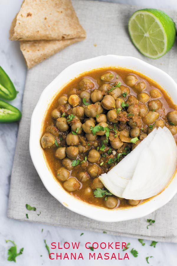 Slow Cooker Chana Masala - Simple wholesome Chana Masala is the most popular Indian curry which youcan make in slow cooker with just 15 mins hands on work! Packed with tons of flavor and protein!