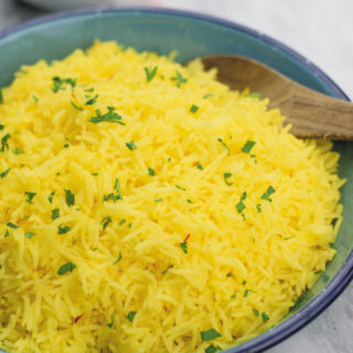 Easy Yellow Saffron Rice - Better Than your favorite Mediterranean restaurant, this SIMPLE yellow saffron rice is full of flavor & GREAT as a side!