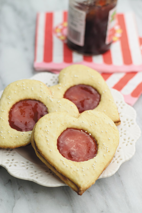 Coconut & jam heart cookies - Coconut cookies with strawberry jam sandwiched in between. So good, just few ingredients and ready in under an hour!