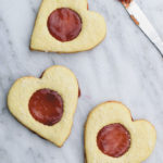 Coconut & jam heart cookies - Coconut cookies with strawberry jam sandwiched in between. Perfect valentines day treat or anytime snack!