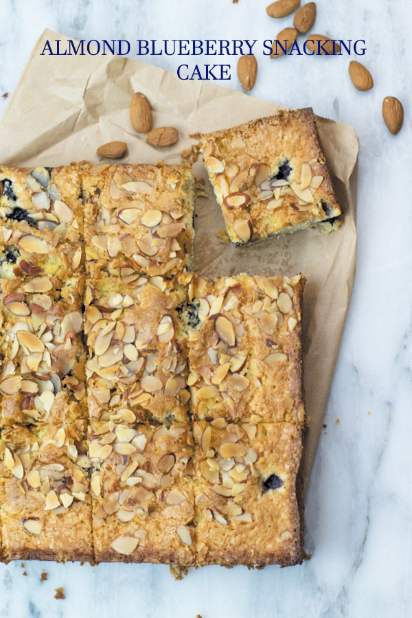 almond blueberry snacking cake with roasted almonds title