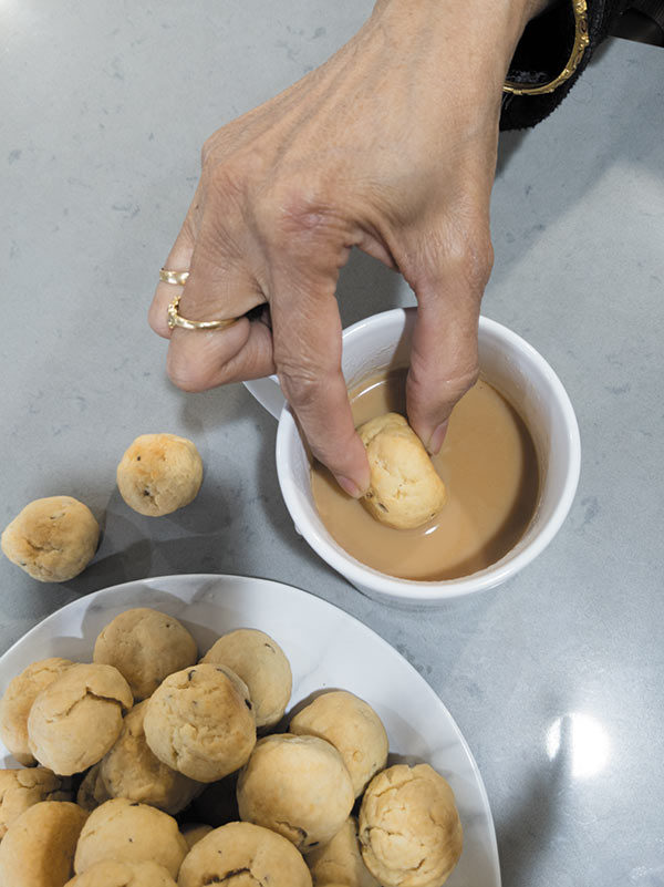 Surati caraway Biscuits eating with chai