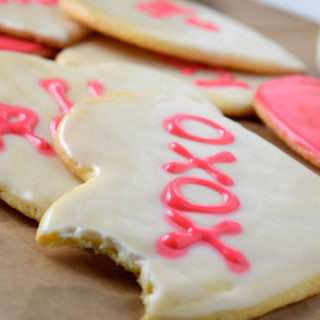 Bite from Conversation Heart Shaped Sugar Cookies
